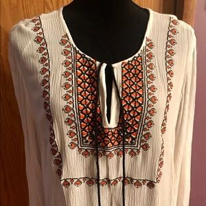 Embellished top .  Light weight and comfy.